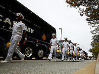 Navy players walk off the busses and enter the stadium before the college football game between the Ohio State Buckeyes and the Navy Midshipmen at M&T Bank Stadium in Baltimore, Saturday morning, August 30, 2014. (The Columbus Dispatch / Eamon Queeney)