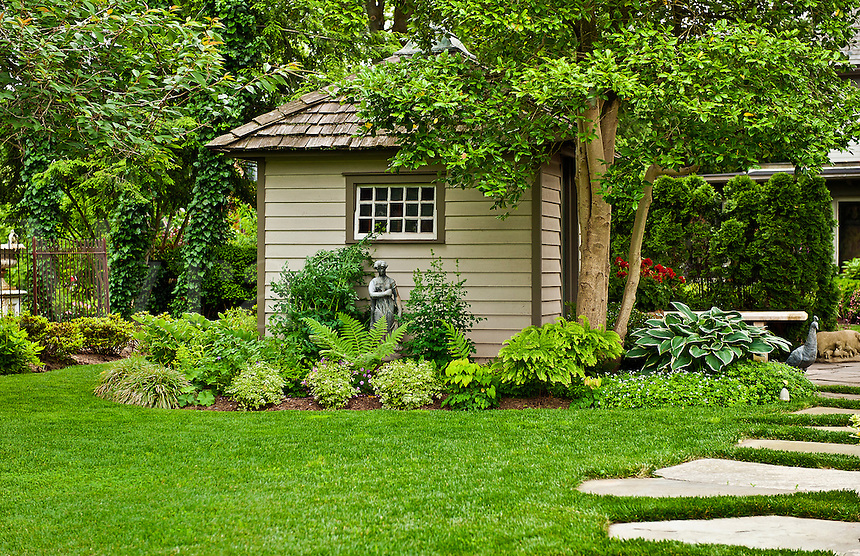 Manicured lawn and attractive landscaping.