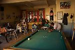 Bar Aquila avec son billard retro et ses anciennes  publicites pour campari et coca cola.Aquila bar with it's vintage billiardo and it's old campari advertisements