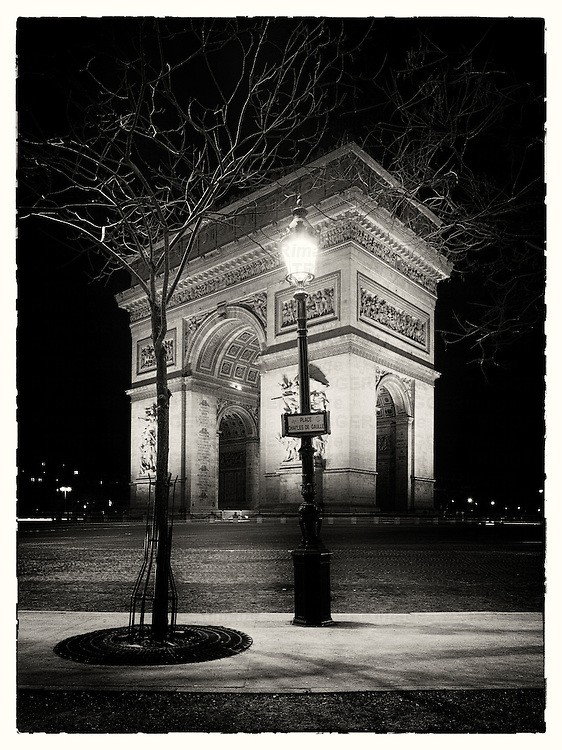 Arc de Triomphe at night Paris France