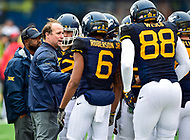 Morgantown, WV - NOV 18, 2017: West Virginia Mountaineers head coach Dana Holgorsen talks to his team during a timeout of the game between West Virginia and Texas at Mountaineer Field at Milan Puskar Stadium Morgantown, West Virginia. (Photo by Phil Peters/Media Images International)