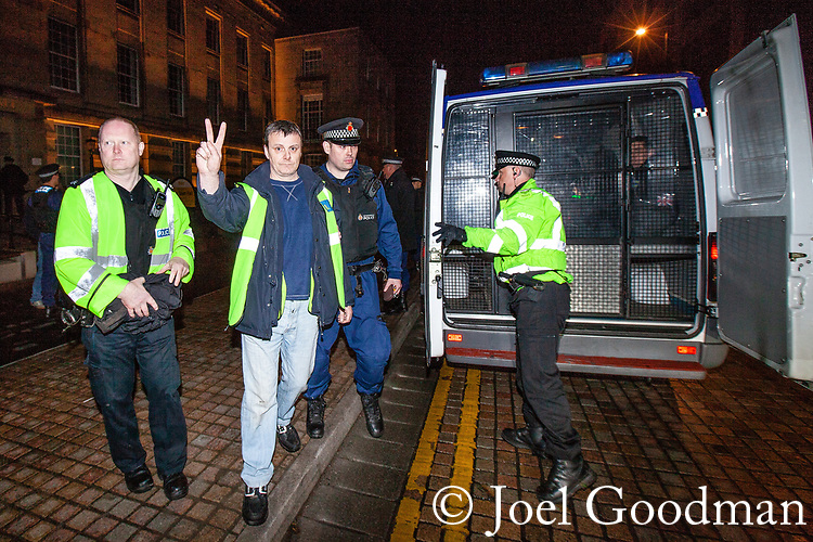 "© Joel Goodman - 07973 332324 . 03/03/2012 . Heywood , UK . Police bring protesters down from the roof . Following a National Front demonstration in nearby Heywood, a rooftop demonstration by the ""North West Infidels"" and the ""Combined Ex Forces"" is held on Bury Town Hall. Police said the group had climbed up scaffolding at the side of the Town Hall building to gain roof access. Protesters have affixed banners stating ""Hang paedo scum"" and various nationalist slogans . Photo credit : Joel Goodman"