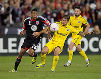 Lionard Pajoy (26) of D.C. United fights for the ball with Carlos Mendes (4) of the Columbus Crew during the game at RFK Stadium in Washington, DC.  D.C. United defeated the Columbus Crew, 3-2.