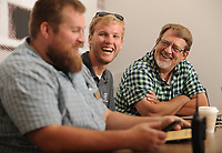 NWA Democrat-Gazette/ANDY SHUPE<br /> Mike Gilbert (right) laughs Wednesday, July 5, 2017, with Zak Heald (center), director of Intercut Productions, and Hunter Rogers of the Jones Center, during a meeting at the Jones Center in Springdale.