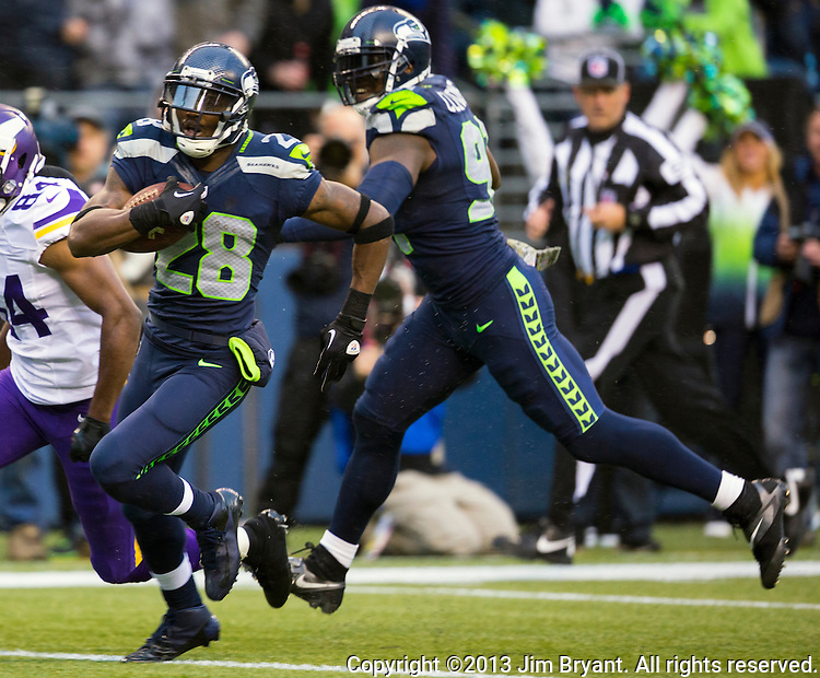 Seattle Seahawks  cornerback Walter Thurmond runs back a pass interception for a touchdown against the Minnesota Vikings  at CenturyLink Field in Seattle, Washington on  November 17, 2013.  The Seahawks beat the Vikings 41-20.  ©2013.  Jim Bryant. All Rights Reserved.