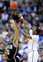 Ashton Gibbs of the Panthers gets off a shot against Bulldogs' Ronald Nored. Butler upset no.1 seed Pittsburgh 71-70 during the 3rd round of the NCAA Tournament at the Verizon Center in Washington, D.C on Saturday, March 19, 2011. Alan P. Santos/DC Sports Box