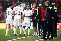 Wayne Routledge of Swansea City talks to the backkroom staff during the Barclays Premier League match between AFC Bournemouth and Swansea City played at The Vitality Stadium, Bournemouth on March 12th 2016