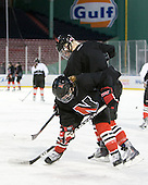 Kelly Wallace (NU - 5), Cassie Sperry (NU - 21) - The Northeastern University Huskies practice on the ice at Fenway Park on Thursday, January 7, 2010, in Boston, Massachusetts.