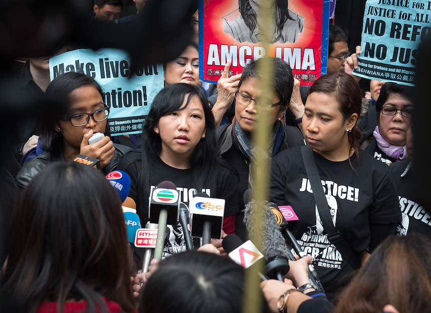 Abused Indonesian domestic helper Erwiana Sulistyaningsih talks to the media on the steps of the District Court in Wan Chai, Hong Kong. She suffered abuse at the hands of Law Wan-tung who was sentenced to six years in prison today.February 2015. 27.02.15<br /> &copy;Jayne Russell