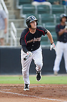 Hunter Jones (1) of the Kannapolis Intimidators starts down the first base line against the Charleston RiverDogs at CMC-NorthEast Stadium on June 27, 2014 in Kannapolis, North Carolina.  The Intimidators defeated the RiverDogs 6-5.  (Brian Westerholt/Four Seam Images)