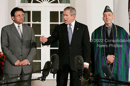 WASHINGTON - SEPTEMBER 27:  (AFP OUT) US President George W. Bush (M) deliver remarks while flanked by Afghanistan President Hamid Karzai (R) and Pakistani President Pervez Musharraf (L) in the Rose Garden at the White House September 27, 2006 in Washington, DC. Bush is hosting a meeting between the two leaders. (Photo by Mark Wilson/Getty Images) *** Local Caption *** Hamid Karzai;George W. Bush;Pervez Musharraf
