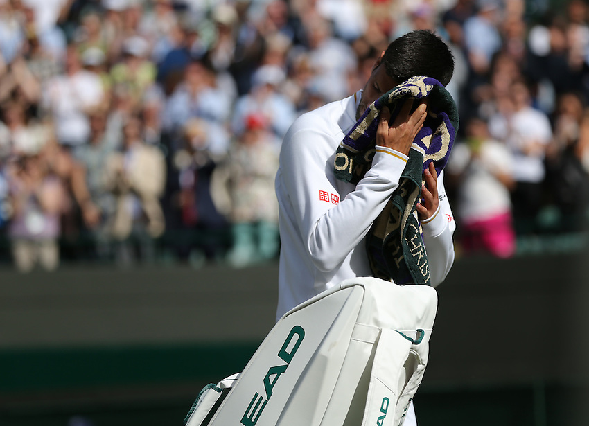 Novak Djokovic of Serbia reacts after his defeat by Sam Querrey of USA in their Gentlemen's Singles Third Round match today<br /> <br /> Photographer Stephen White/CameraSport<br /> <br /> Tennis - Wimbledon Lawn Tennis Championships - Day 6 - Saturday 2nd July 2016 -  All England Lawn Tennis and Croquet Club - Wimbledon - London - England<br /> <br /> World Copyright &copy; 2016 CameraSport. All rights reserved. 43 Linden Ave. Countesthorpe. Leicester. England. LE8 5PG - Tel: +44 (0) 116 277 4147 - admin@camerasport.com - www.camerasport.com