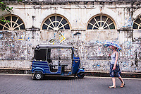 Tourist exploring the streets of the Old Town of Galle, a UNESCO World Heritage Site on the South Coast of Sri Lanka, Asia. This is a photo of a tourist exploring the streets of the Old Town of Galle, a UNESCO World Heritage Site on the South Coast of Sri Lanka, Asia.