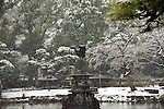 February 14, 2014, Tokyo, Japan - Snow keeps falling on the statue of crane at Tokyo's Hibiya Park on Friday, February 14, 2014. Two weeks in a row, the nation's capital was blanketed with inches of snow as a low-pressure front hit a wide swath along the Pacific coasts, disrupting land, sea and air transportation services.  (Photo by Natsuki Sakai/AFLO)