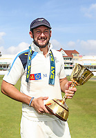 Picture by Alex Whitehead/SWpix.com - 12/09/2014 - Cricket - LV County Championship Div One - Nottinghamshire CCC v Yorkshire CCC, Day 4 - Trent Bridge, Nottingham, England - Yorkshire's Tim Bresnan celebrates with the trophy.