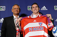 The first pick of FC Dallas and the fifth pick overall Zach Loyd (University of North Carolina) with head coach Schellas Hyndman during the MLS SuperDraft at the Pennsylvania Convention Center in Philadelphia, PA, on January 14, 2010.
