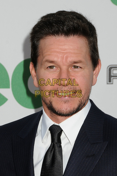 Mark Wahlberg.The L.A. Premiere of 'Ted' held at The Grauman's Chinese Theatre in Hollywood, California, USA..June 21st, 2012.headshot portrait blue suit black tie white shirt stubble facial hair .CAP/ADM/BP.©Byron Purvis/AdMedia/Capital Pictures.