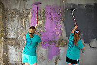 "Members roll on a fresh coat of paint under a train bridge during ""Circle the City with Service,"" the Kiwanis Circle K International's 2015 Large Scale Service Project, on Wednesday, June 24, 2015, in Indianapolis. (Photo by James Brosher)"