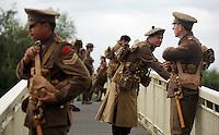 Men in World War I gear on a footbridge in the Dyfatty area of Swansea, south Wales UK. Friday 01 July 2016