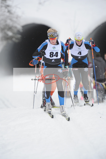 Chugiak's C team member Rand Nolan  (84) and A team member Brian Wing (4) race at the Chugiak Stampede Saturday, January 14, 2017.  Photo for the Star by Michael Dinneen