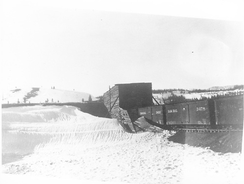 View from main track toward east leg of D&amp;RG Cumbres wye snowshed.  Boxcars on east leg of wye.<br /> D&amp;RG  Cumbres, CO  ca. 1919