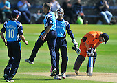 Cricket One Day International - Scotland V The Netherlands at Mannofield - Aberdeen - Scotland's Kyle Coetzer celebrates bowling Netherlands batsman Neil Kruger as his team-mates gather to join in - Picture by Donald MacLeod - 28.6.11 - 07702 319 738 - www.donald-macleod.com