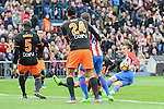 Atletico de Madrid's Antoine Griezmann and Valencia CF's Eliaquim Mangala and Ezequiel Garay during La Liga match between Atletico de Madrid and Valencia CF at Vicente Calderon Stadium  in Madrid, Spain. March 05, 2017. (ALTERPHOTOS/BorjaB.Hojas)