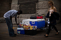 A man organizes snacks for customers at the Brooklyn Bridge while it remains under maintenance one day before its 130th anniversary in New York,  May 23, 2013, Photo by Eduardo Munoz Alvarez / VIEWpress.