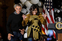 United States President Barack Obama and first lady Michelle Obama speak during a Halloween event in the East Room of the White House October 31, 2016 in Washington, DC. The first couple hosted local children and children of military families for trick-or-treating at the White House.<br /> Credit: Olivier Douliery / Pool via CNP /MediaPunch
