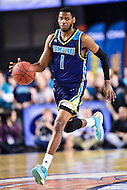 MAR 7, 2016: Baltimore, MD - Tournament MVP North Carolina-Wilmington Seahawks guard Chris Flemmings (1) brings the ball up court against Hofstra Pride during the Championship game of the CAA Basketball Tournament at Royal Farms Arena in Baltimore, Maryland. (Photo by Philip Peters/Media Images International)