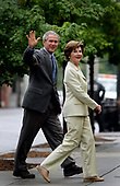 Washington, D.C. - June 25, 2006 -- United States President George W. Bush and first lady Laura Bush wave to the White House press corps before entering St. John's Church for Sunday Mass on June 25, 2006.<br /> Credit: Jay L. Clendenin - Pool via CNP