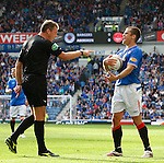 Referee Iain Brines jabs his finger at Jerome Rothen as Rangers French winger tries to take a quick free-kick in the dying minutes much to the dismay of the player