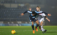 Aaron Amadi-Holloway of Wycombe Wanderers & Alan Smith of Notts County battle for the ball during the Sky Bet League 2 match between Wycombe Wanderers and Notts County at Adams Park, High Wycombe, England on 15 December 2015. Photo by Andy Rowland.