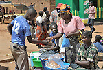 Sisiwe Luhana sells her donuts in an outdoor market in Ekwendeni, Malawi. She benefits from receiving credit from a community loan fund sponsored by the Church of Central Africa Presbyterian.
