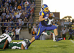 BROOKINGS, SD - SEPTEMBER 6:  Zach Zenner #31 from South Dakota State University high steps out of a pair of tacklers from Cal Poly for a touchdown in the second half of their game Saturday evening at Coughlin Alumni Stadium in Brookings.(Photo/Dave Eggen/Inertia)