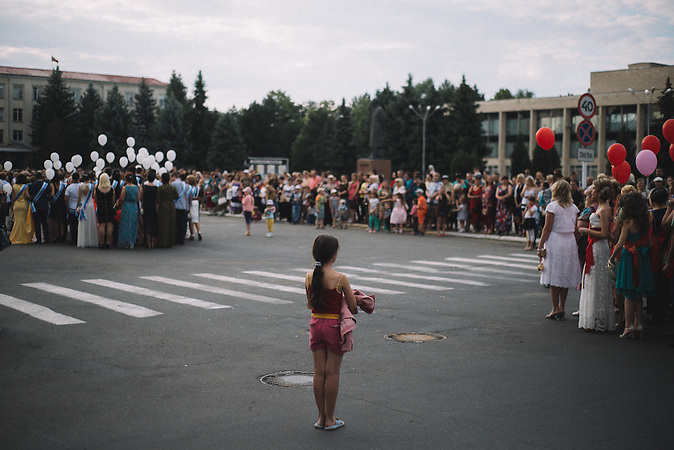 Girl standing in central square of Ribnita during prom manifestation.
