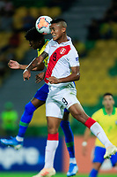 ARMENIA, COLOMBIA - JANUARY 19: Peru's Christopher Olivares jumps for the ball against Brazil's Robson Bambu during their CONMEBOL Pre-Olympic soccer game at Centenario Stadium on January 19, 2020 in Armenia, Colombia. (Photo by Daniel Munoz/VIEW press/Getty Images)