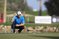 Chris Wood (ENG) lines up his putt on the 18th green during Friday's Round 3 of the Commercial Bank Qatar Masters 2013 at Doha Golf Club, Doha, Qatar 25th January 2013 .Photo Eoin Clarke/www.golffile.ie