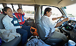 Grace Hernandez (right) drives refugees from El Salvador to the airport in San Antonio, Texas, on December 2, 2015. Behind her is Silvia Penado and her son Jacobo, who points excitedly at an airplane. They fled their country to escape gang-related violence. After requesting political asylum in the United States, they were held for several days by immigration officials and then released, although Penado was required to wear an ankle monitor. They stayed briefly in a shelter run by the Refugee and Immigrant Center for Education and Legal Services (RAICES) and supported by a coalition of San Antonio churches, then flew to another location in the U.S. while they await final decisions on their asylum petitions. Hernandez is a volunteer with RAICES.