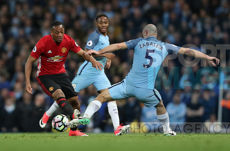 Anthony Martial of Manchester United and Pablo Zabaleta of Manchester City during the English Premier League match at The Etihad Stadium, Manchester. Picture date: April 27th, 2016. Photo credit should read: Lynne Cameron/Sportimage