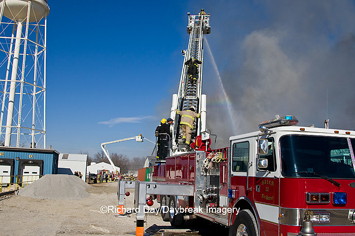 63818-02304 Firefighters extinguishing warehouse fire using aerial ladder truck, Salem, IL