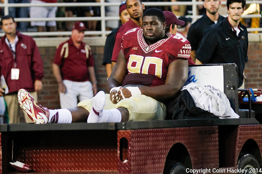 TALLAHASSEE, FL 9/6/14-FSU-CITADEL-Florida State's Eddie Goldman is taken from the field during first half action against the Citadel,   Sept. 6, 2014 at Doak Campbell Stadium in Tallahassee. <br /> <br /> COLIN HACKLEY PHOTO