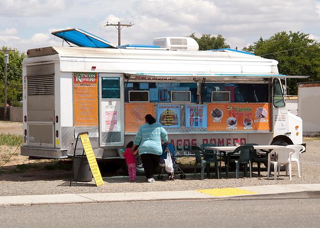 Galt CA, A mobile taco truck turns an empty lot into a sidewalk restaurant.