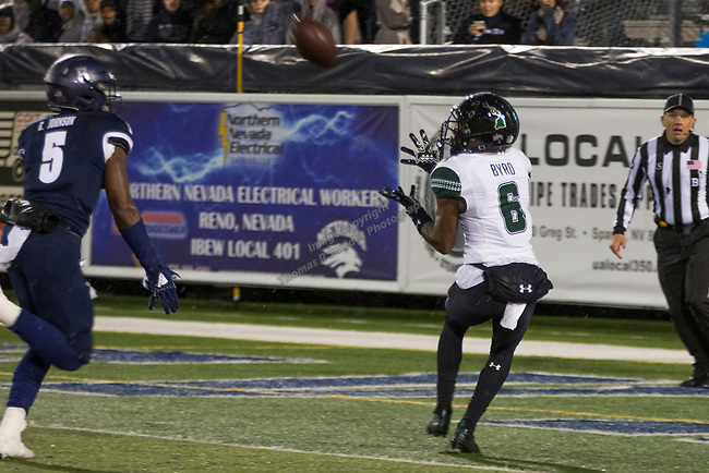 Hawaii wide receiver Cedric Byrd II (6) make the catch for a touchdown over Nevada's Emany Johnson (5) in the first half of an NCAA college football game in Reno, Nev. Saturday, Sept. 28, 2019. (AP Photo/Tom R. Smedes)