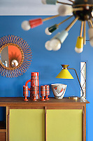 A collection of ceramics is displayed on a retro sideboard in the living room