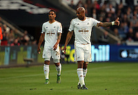 Andre Ayew of Swansea gives the thumbs up to a team mate during the Barclays Premier League match between Swansea City and Arsenal at the Liberty Stadium, Swansea on October 31st 2015