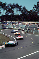 A group of cars race toward Tetre Rouge during the 1984 24 Hours of Le Mans.