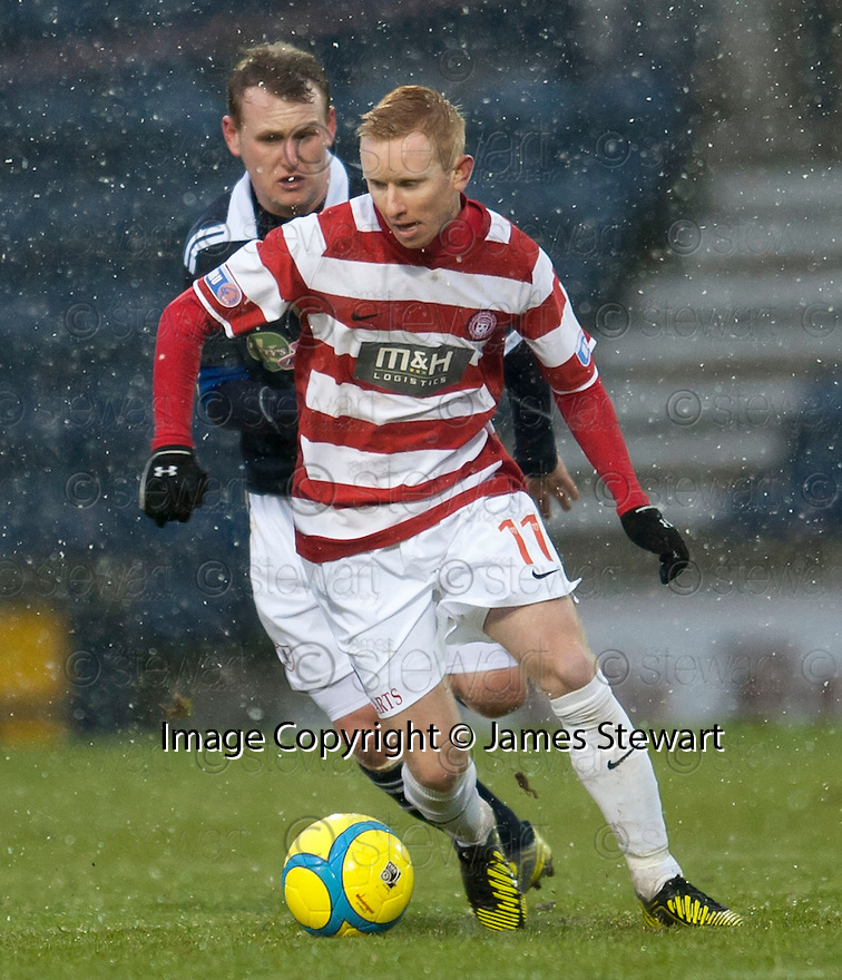Accies Alister Crawford holds off Raith's Allan Walker.