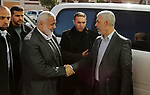 Hamas leader Ismail Haniya shakes hands with Hamas's leader in the Gaza Strip Yahya Sinwar before a meeting with heads of Palestinian families in Gaza city on December 26, 2017. Photo by Ashraf Amra