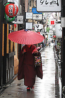 A Geisha and the Red Umbrella - Kyoto